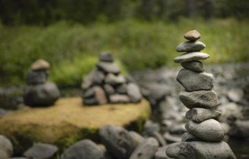 A pile of rocks near a stream.